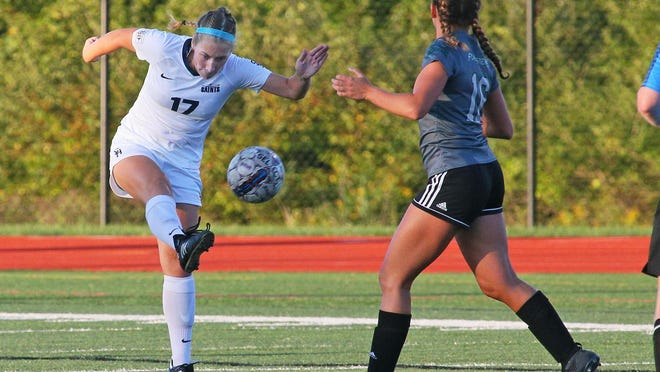 Siena Heights' Hannah Moening kicks the ball up field during a game in 2019.