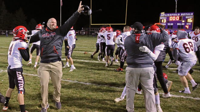 Clinton head coach Jeremy Fielder jumps in the air following his team's Division 6 district championship win at Blissfield.