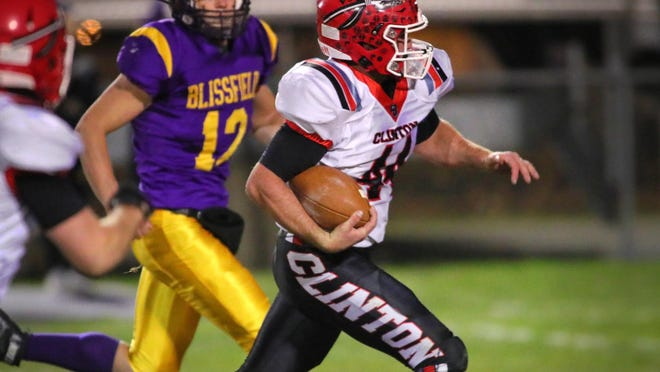 Clinton's Brayden Randolph (44) rushes for a first down as Blssfield's Gavin Ganun (12) chases during their Division 6 district final at Blissfield on Nov. 13.