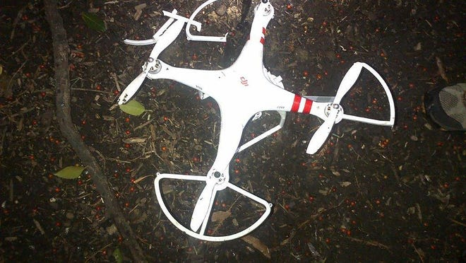 This handout photo provided by the US Secret Service shows the drone that crashed onto the White House grounds in Washington, Monday, Jan. 26, 2015. A small drone flying low to the ground crashed onto the White House grounds before dawn Monday, triggering a major emergency response and raising fresh questions about security at the presidential mansion. A man later came forward to say he was responsible and didn't mean to fly it over the complex. The man contacted the Secret Service after reports of the crash spread in the media, a U.S. official said. The man told the agency that he had been flying the drone recreationally. The man is a Washington resident and is cooperating with investigators. (AP Photo/US Secret Service)