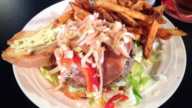 The Manilla burger ($10.49), a black Angus beef patty topped with capocollo ham, sriracha slaw, and wasabi mayonnaise at Short's Burgers Eastside in Iowa City.