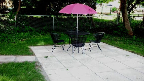 The first of several patio tables is ready for business at The Mad Hatter.