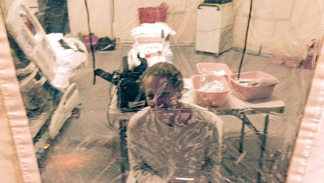 This Sunday, Oct. 26, 2014 photo provided by attorney Steven Hyman shows nurse Kaci Hickox in an isolation tent at University Hospital in Newark, N.J., where she was quarantined after flying into Newark Liberty International Airport following her work in West Africa caring for Ebola patients.