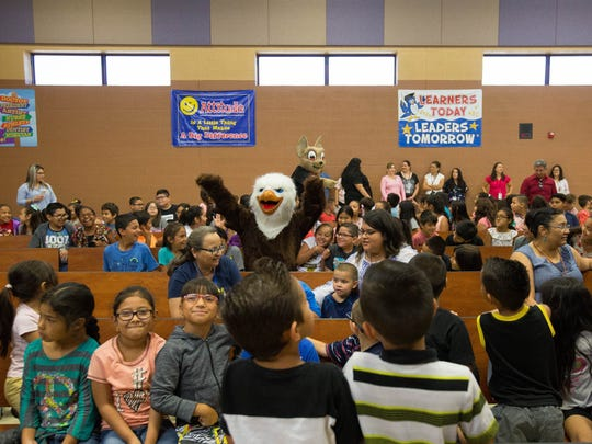 Students, teachers, parents and Buddy the Eagle, along with Chico the Chihuahua, gather at Anthony Elementary School to celebrate Gadsden Independent School District testing results, Monday July 16, 2018.