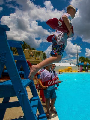 Members of the junior lifeguard camp at Sun Splash water park in Cape Coral practice rescue procedures during a group exercise class.