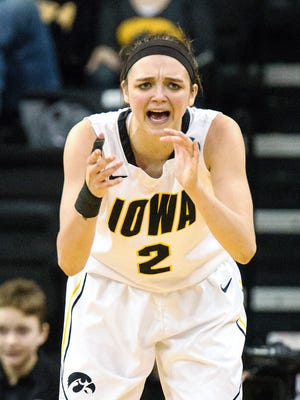 Iowa's Ally Disterhoft (2) rally her team in the second half of play during the second round of the NCAA Women's Basketball Championship at Carver-Hawkeye Arena in Iowa City on Sunday, March 22, 2015. The Hawkeyes beat the Hurricanes 88-70 to advance to the Sweet 16.