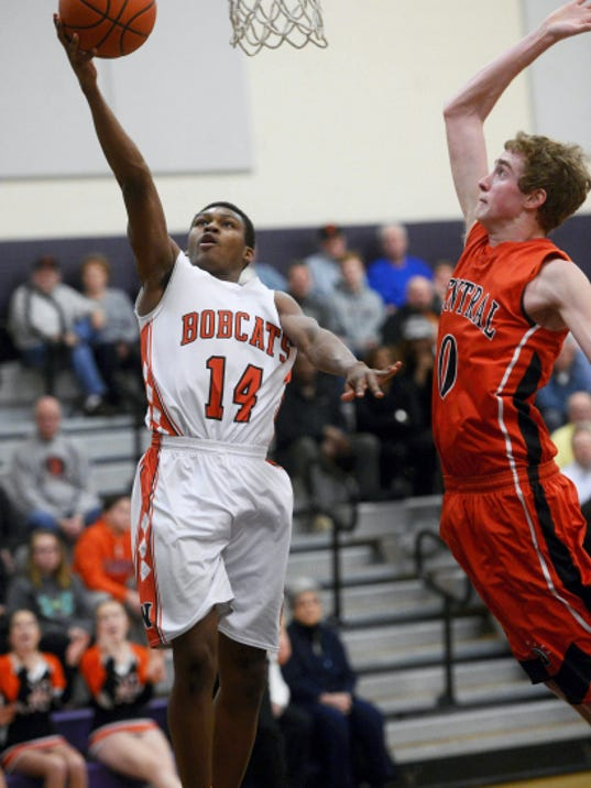 Northeastern's DeAireus Brown, left, shoots against Central York's Mitch Marino during Tuesday's District 3 Class AAAA consolation game at Northern York High School.