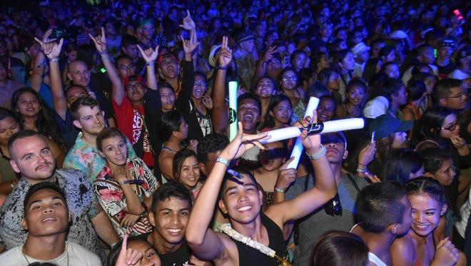 Crowd members pose for the camera during the Guam Live International Music Festival at Gov. Joseph Flores Memorial Park in Tumon on May 29.