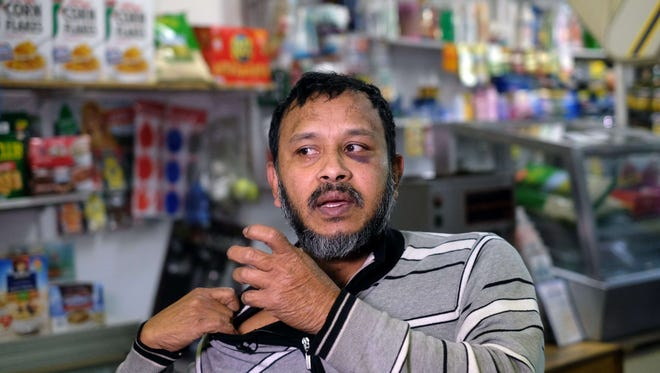 """Muslim shopkeeper Sarker Haque, who was beaten in an alleged hate crime, speaks at his shop in New York on Dec. 7, 2015. Muslim-American leaders accused Republican presidential hopeful Donald Trump of incitement for demanding a """"complete shutdown"""" of Muslims entering the USA."""