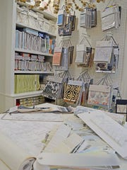 The building includes a space dedicated as a fabric library with built-ins for fabric sample books.