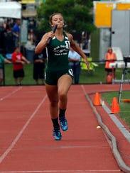 Oak Harbor's Elayna Krupp runs in the girls 800 meter