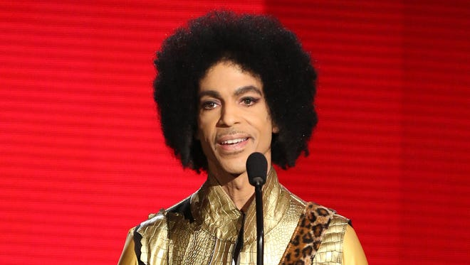 Prince presents the award for favorite album - soul/R&B at the American Music Awards on Nov. 22, 2015, in Los Angeles.