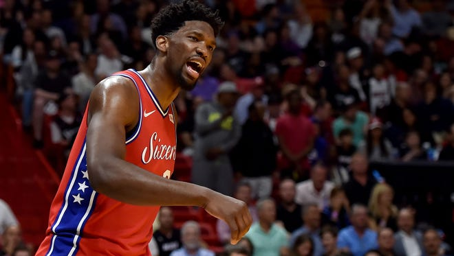 Philadelphia 76ers center Joel Embiid (21) reacts during the second half against the Miami Heat at American Airlines Arena.
