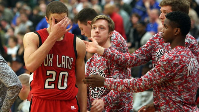 Fox Lane's Matt Redhead (20) walks off the court after fouling out late in the game against Middletown during the boys basketball Class AA regional  finals at Orange Community College in Middletown March 4, 2016. Middletown won the game 62-44.
