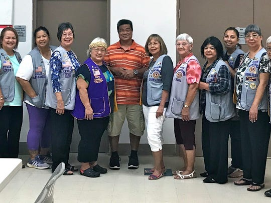 "The Guam Sunshine Lions Club participated in the Archdiocese of Agana's ministry to the homeless by providing 60 pre-packaged dinner boxes, water, and fruit at the Dededo Senior Citizen Center on May 12, 2018.  In addition to the club's main project of ""Caring for the Sick and the Elderly, Sunshine Lions also serve the community in various ways, such as feeding the hungry. Pictured from left: Lions Frank Aguon, Jr., Jill Pangelinan, Danny Cruz, Clare Cruz, Lorraine Rivera, Julie Cruz, Julie Garcia, Marietta Camacho, and Ewy Taitano; Chris Diego (program assistant with the Ministry to the Homeless); Lions Rosie Matsunaga, Helen Mendiola, Connie Rivera, Tish Tano, Annie Artero, Jovie Mejorada, Beverly Dorion, Sophie Losongco, and Pete Babauta."