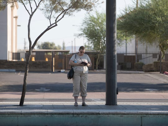 Marcy Morrs waits for the train on 19th Avenue and
