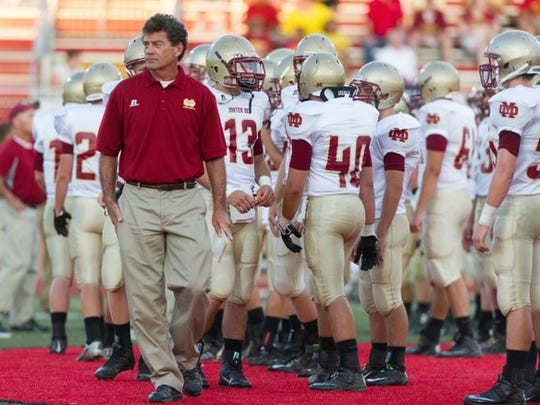 Mater Dei Head Coach Mike Goebel paces the sidelines during a game against Harrison at Roman Stadium in this file photo from September 5, 2014.