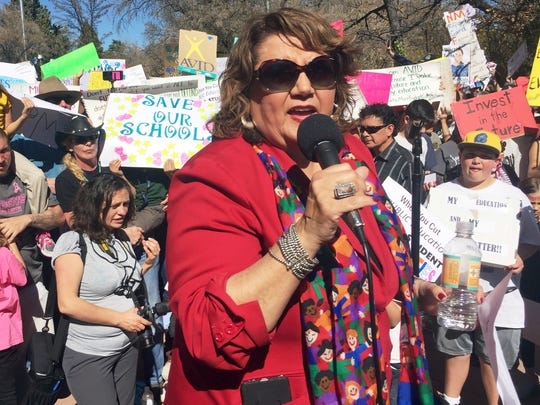 Santa Fe Public Schools Superintendent Veronica Garcia addresses a rally at the New Mexico state Capitol in Santa Fe, N.M., to urge lawmakers and the governor to bolster spending on K-12 schools for the coming fiscal year,Thursday, March 16, 2017. Garcia canceled classes at mid-day so that staff and students could attend the protest. The state cut public education funding in October and this year swept funding from school district reserves to plug a current-year deficit.