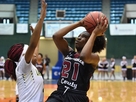 Lawrence County's Kyunna Thomas (21) shoots against