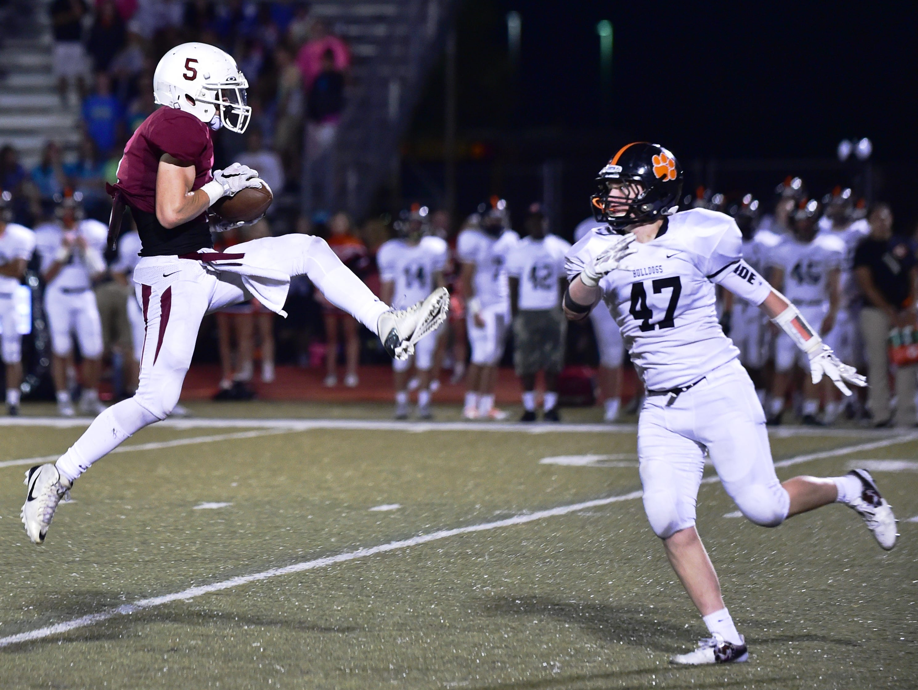Milford's Logan Kahl makes the leaping catch in front of Brighton's Mike Redlinger.