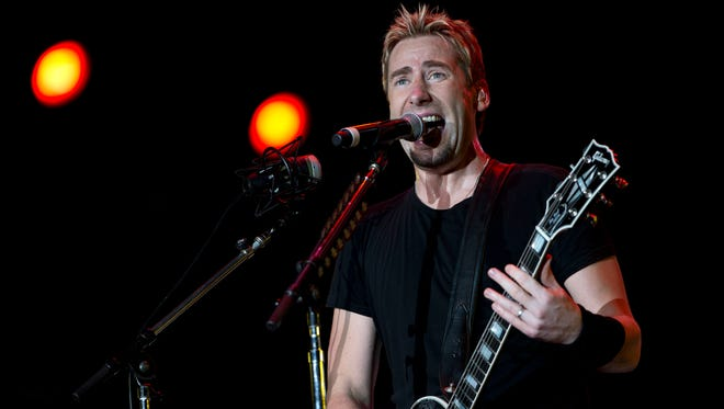 Guitarist and singer Chad Kroeger, of the Canadian rock band Nickelback, performs during the annual Rock in Rio music festival in Rio de Janeiro, Brazil, Friday, Sept. 20, 2013. More than 80 thousand people a day are expected to attend the week-long festival which features over 120 bands and artists and runs from  runs until Sunday. Conceived by the entrepreneur Roberto Medina, the first Rock in Rio took place in the Rio de Janeiro in 1985. (AP Photo/Silvia Izquierdo)