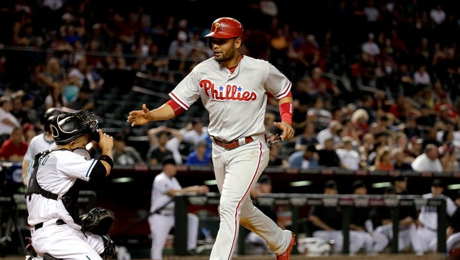 Philadelphia Phillies' Andres Blanco scores the winning run against the Arizona Diamondbacks after being walked in during the ninth inning of a baseball game, Tuesday, June 28, 2016, in Phoenix.