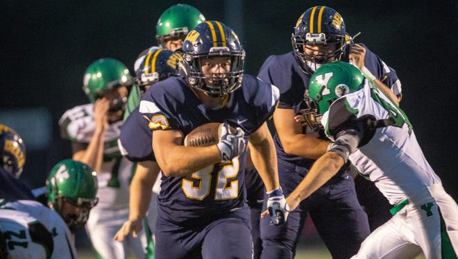 Delta's Charlie Spegal tears through the center during the game against Yorktown on Sept. 8 at Delta High School. Spegal had 36 carries, 340 yards and six touchdowns during the game.