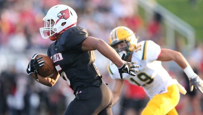 Colerain Cardinals running back Ivan Pace Jr. (5) runs for a touchdown in the first quarter during the high school football game between the Sycamore Aviators and the Colerain Cardinals, Friday, Sept. 15, 2017, at Cardinal Stadium in Colerain Township.