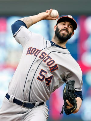 Mike Fiers throws against the Minnesota Twins in the first inning.