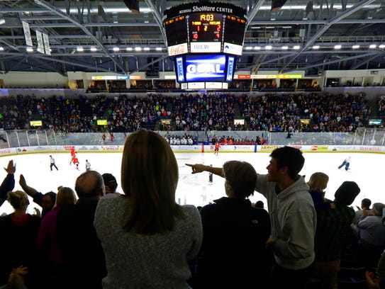 Fans cheer during a Seattle Thunderbirds game this