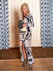 Jan Fleisher models a maxi dress by Sabre Mochachino, a Treasure Coast-based fashion designer.