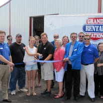 Sheboygan County Chamber Executive Director Betsy Alles and Chamber Ambassadors recently held a ribbon cutting to celebrate the expansion at Grand Rental Station, 3849 Enterprise Dr., Sheboygan. Pictured cutting the ribbon are owner David Kostichka, Chamber Executive Director Betsy Alles, friends and supporters.