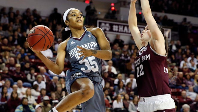 Mississippi State forward Victoria Vivians tries to pass around Texas A&M guard Danni Williams in the first half on Sunday.