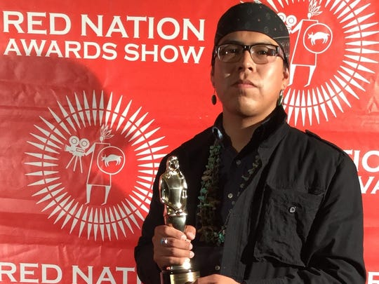 Shiprock native Kody Dayish receives the award for Emerging First Time Director at the Red Nation Film Festival in Los Angeles in November.