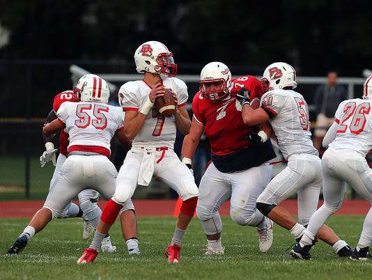 636423240959465821-Bound-Brook-quarterback-Dave-Lepoidevin-drops-back-to-pass-at-Dunellen-9-1-17.jpg