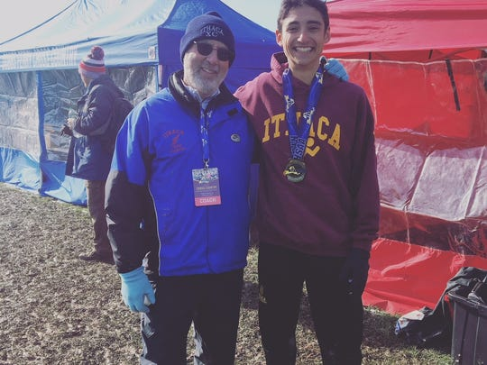 Rich Bernstein with Silas Derfel after Derfel ran to the Class A state title in November of 2017 at Wayne High School.