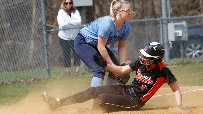 Suffern's Kristin Tarantino (25) tries to tag out Mamaroneck's Gianna Magrino (2) during the 2nd inning at Suffern on Apr. 10, 2017.