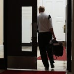 James Ramsey exits the building as the U of L Board went into open session Wednesday night.