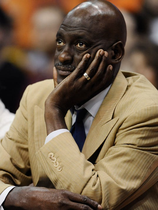 Atlanta Dream head coach Michael Cooper watches play during the second half of a WNBA basketball game against the Connecticut Sun, Sunday, Aug. 17, 2014, in Uncasville, Conn. The Sun won 84-55.  (AP Photo/Jessica Hill)