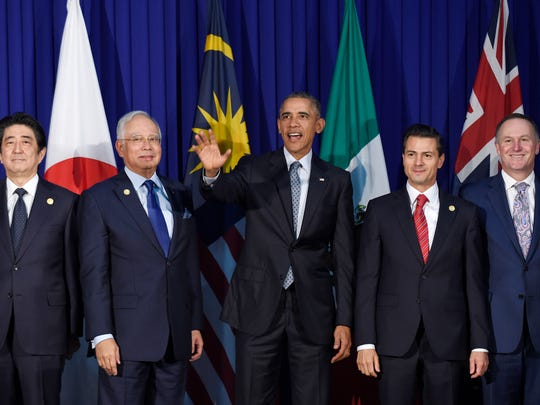 President Barack Obama, center, and other leaders of the Trans-Pacific Partnership countries pose for a photo in Manila, Philippines, Wednesday, Nov. 18, 2015, ahead of the start of the Asia-Pacific Economic Cooperation (APEC) summit. The leaders are, from left, Japan's Prime Minister Shinzo Abe, Malaysia's Prime Minister Najib Razak, President Obama, Mexico's President Enrique Pena Nieto, New Zealand's Prime Minister John Key.