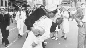 """""""V-J Day in Times Square"""" was first published in """"Life"""" with the caption """" In New York's Times Square a white-clad girl clutches her purse and skirt as an uninhibited sailor plants his lips squarely on hers."""""""