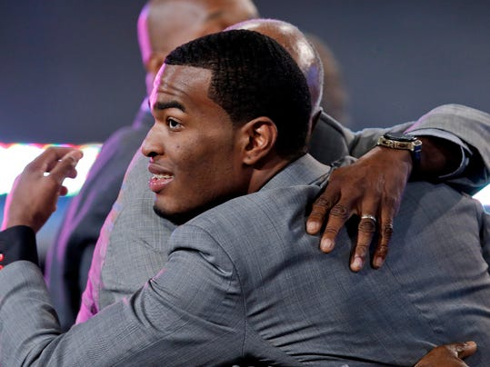 North Carolina State's T.J. Warren, right, is congratulated after being selected 14th overall by the Phoenix Suns during the 2014 NBA draft, Thursday, June 26, 2014, in New York.  (AP Photo/Kathy Willens)