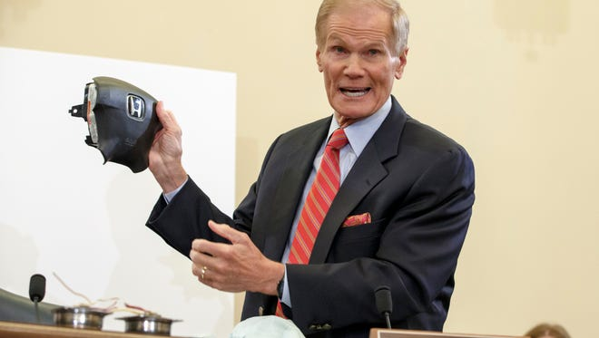 In this Thursday, Nov. 20, 2014, file photo, Senate Commerce Committee member Sen. Bill Nelson, D-Fla., displays the parts and function of a defective airbag made by Takata of Japan.