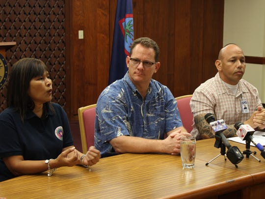 In this file photo, Barrigada Mayor June Blas, left, Lt. Gov. Ray Tenorio, center, and acting Police Chief Joseph Cruz discuss upgrades to the Neighborhood Watch program.