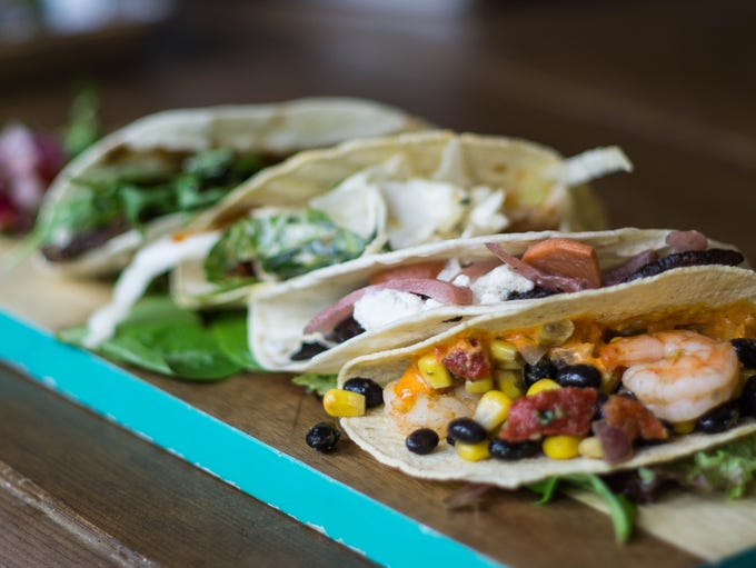 Lucy's in the Square serves up their tacos with your