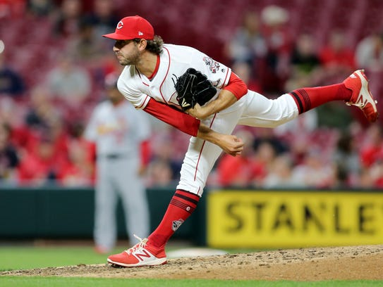 Cincinnati Reds relief pitcher Zack Weiss (49) delivers