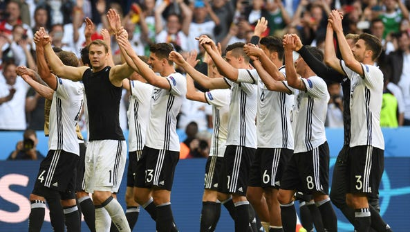 Germany's players celebrate at the end of the Euro