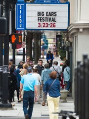 Big Ears Festival attendees walk toward the Bijou Theatre before the Theo Bleckmann Quintet went on stage March 25, 2017.