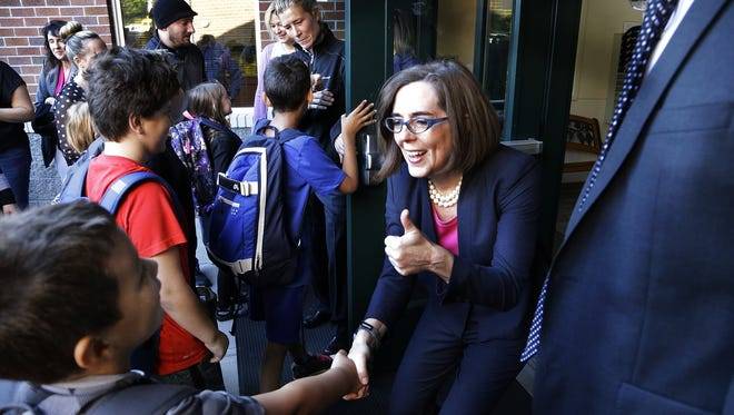 Oregon Gov. Kate Brown greets students on the first day of school at Nancy Ryles Elementary School in Beaverton, Ore., Tuesday, Sept. 8, 2015.  Brown visited the school kicking off the first school year with full-day kindergarten statewide. (AP Photo/Don Ryan)