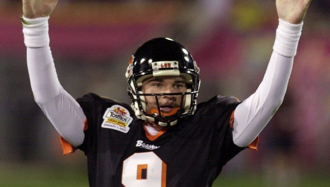 Jonathan Smith, pictured during Oregon State's 41-9 Fiesta Bowl victory over Notre Dame on Jan. 1, 2001, is third in school history in passing yards and touchdown passes.